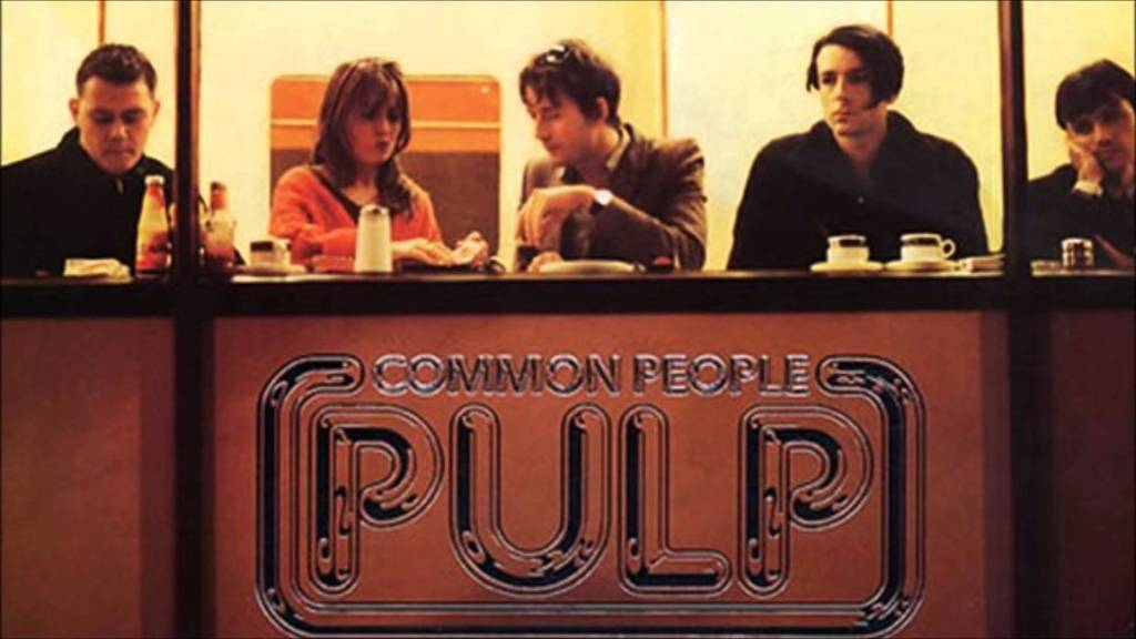 The members of Pulp seated in a diner window, doing what common people do.